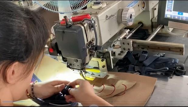 Computer stiching machine , making the webbing tape in shoulderstap